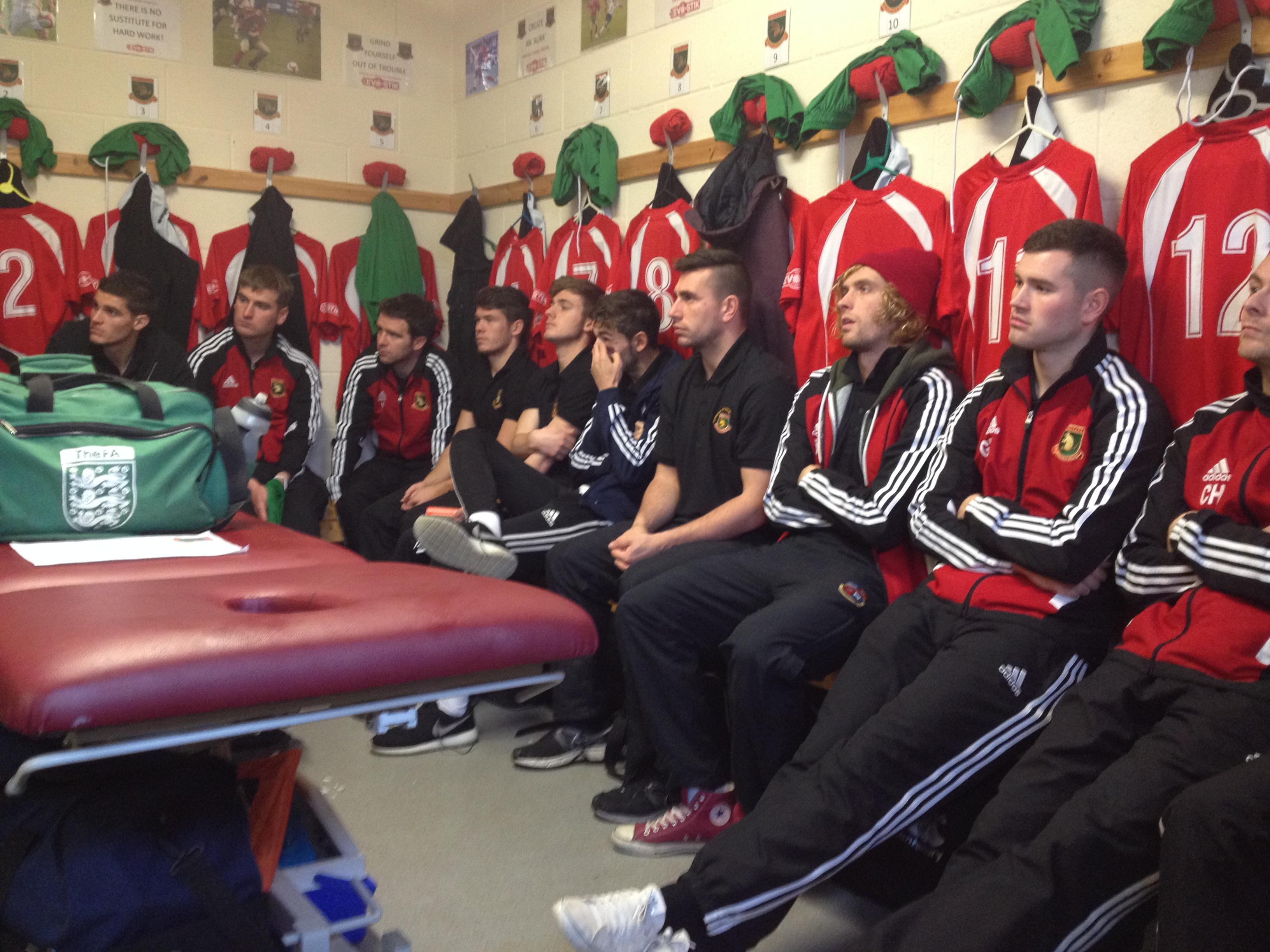 Harrogate Railway players listen to Billy Miller's team-talk