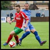 Harrogate Railway's top marksman Nathan Cartman hit the decisive third goal as Railway reached the FA Cup second qualifying round for the first time since 2007