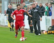Dave Merris strides forward for Ossett Town in their 2-0 defeat to Darlington 1883. Photo: Mark Gledhill