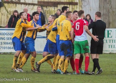 Chaos ensued as referee Jan Suchecki lets players surround him before Akeroyd is sent off