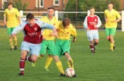 AFC Emley defender Anthony Leech battles for the ball