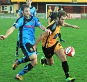 Ossett Albion goal-scorer Connor McDonagh battles in the 3-2 win over Kendal Town. Picture: John Hirst