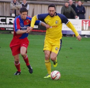 Former Manchester United midfielder Jonathan Greening strides forward for Tadcaster