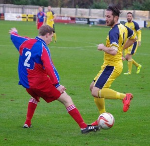 Josh Greening takes on Morpeth's Shaun Henderson