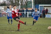 Knaresborough Town striker Mitch Hamilton strikes his penalty which was saved Yorkshire Amateur goalkeeper Suwara Bojang