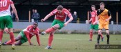 Steve Bromley slots home the winner for Harrogate Railway in the 2-1 victory at New Mills