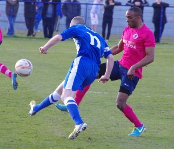Anton Foster in action for Shaw Lane in the FA Vase defe to Glossop