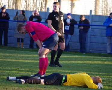 Shaw Lane captain Sam Denton and goalkeeper Ben Gathercole look deflated after Glossop take the lead in the first of extra-time