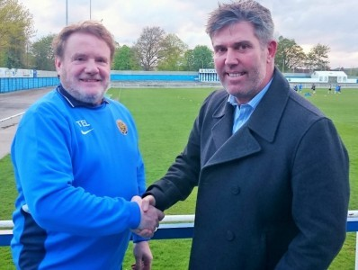 Staveley chairman Terry Damms welcomes Brett Marhall (right) to the club