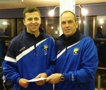 New Garforth Town manager Adrian Costello presents Danny Harris (left) with his man of the match award