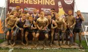The eleven Maltby Main players and joint manager Spencer Fearn after completing the Tough Mudder