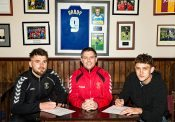 David Reay and Harrison Biggins sign their Stocksbridge contracts with Chris Hilton (centre) watching over. Joe Lumsden (not pictured) has also signed on the dotted line.