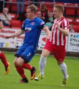 Alex Byrne (left) earned a point for Shaw Lane at AFC Rushden & Diamonds